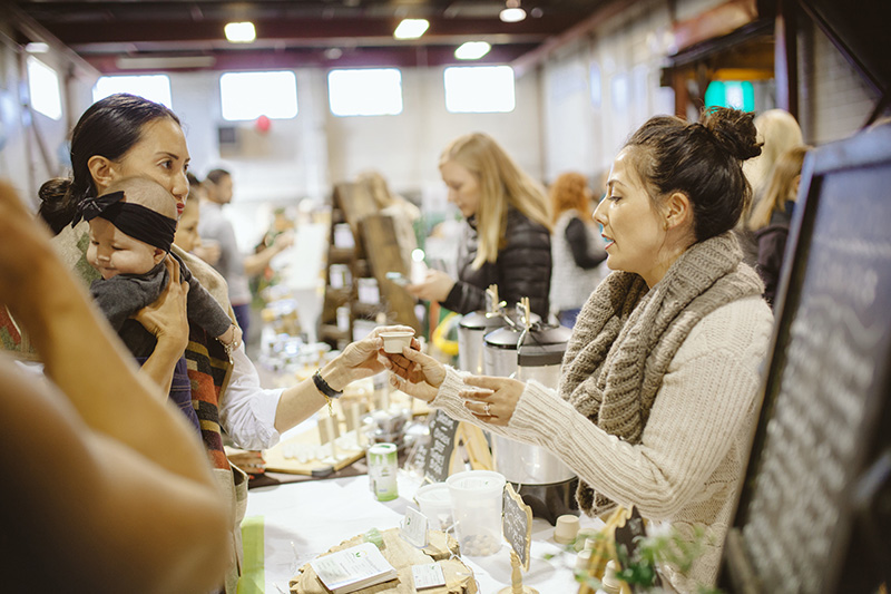 People shop from vendors at a past Market Collective event