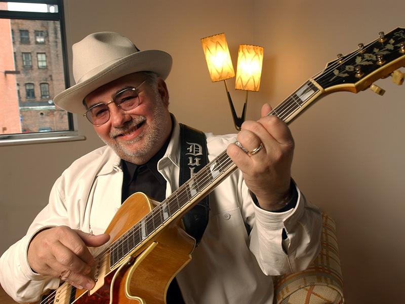 Duke Robillard holds his guitar