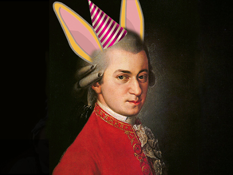 A portrait of Wolfgang Amadeus Mozart with a digital party hat and rabbit ears added