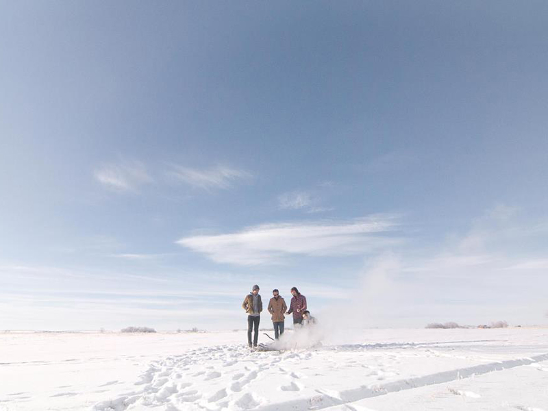 A photo of the Calgary band Cold Water in a snowy winterscape