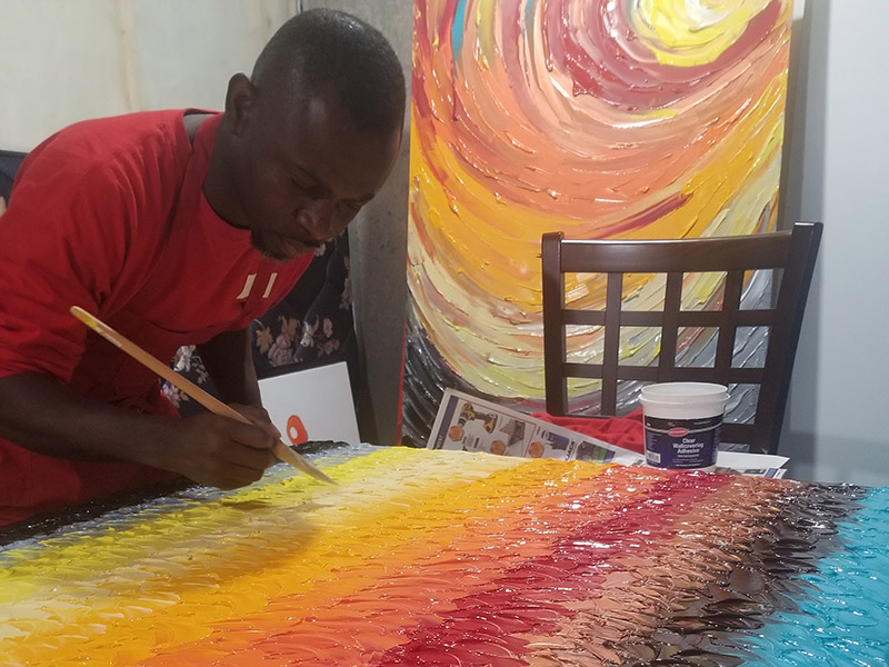Lanre Ajayi paints a bright and colourful canvas