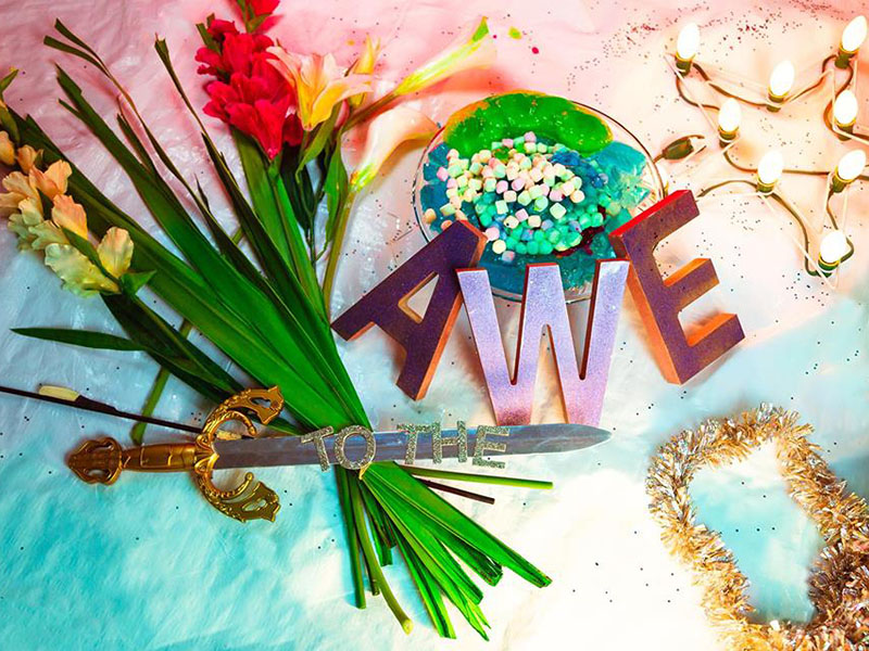 A bright still life with to the AWE spelled out in colourful letters