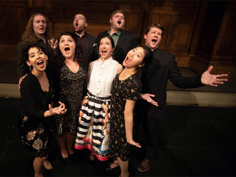 Members of the Calgary Opera's Emerging Artist Program Ensemble strike a pose