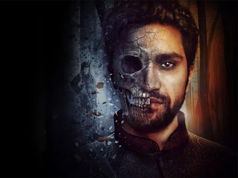 A graphic with a skull superseded over Hamlet's face