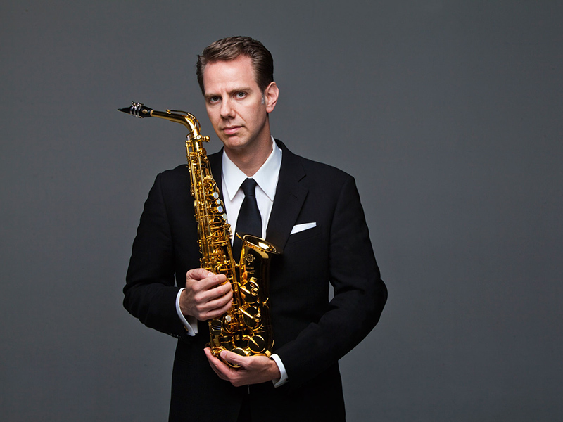 Timothy McAllister holds his saxophone