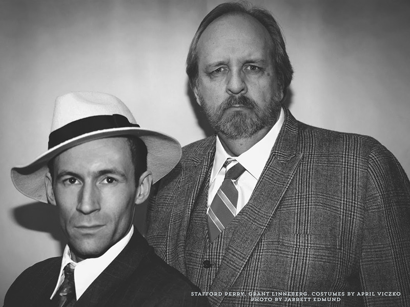 A black and white photo of Stafford Perry and Grant Linneberg in Might As Well Be Dead: A Nero Wolfe Mystery
