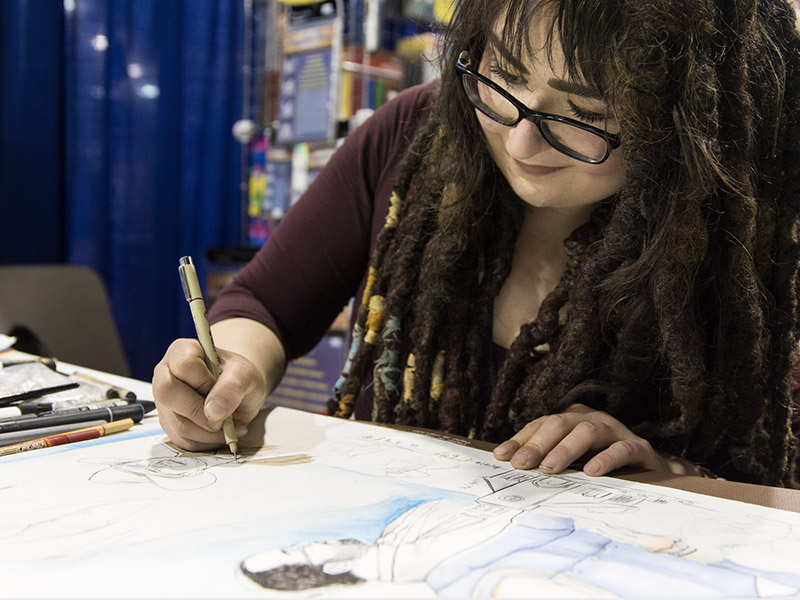 An artist draws in the Calgary Comic & Entertainment Expo's Artist Alley