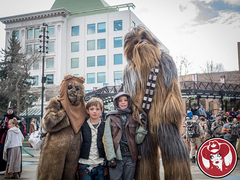 A family dressed as Star Wars characters take part in the POW! Parade of Wonders