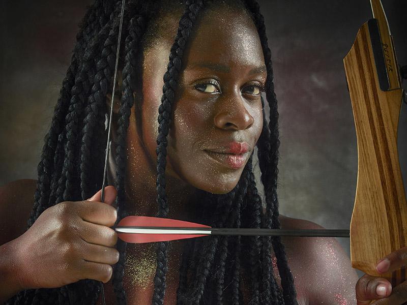 Natasha Korney holds a bow and arrow