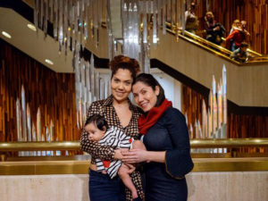 Two people hold a baby at Glenbow