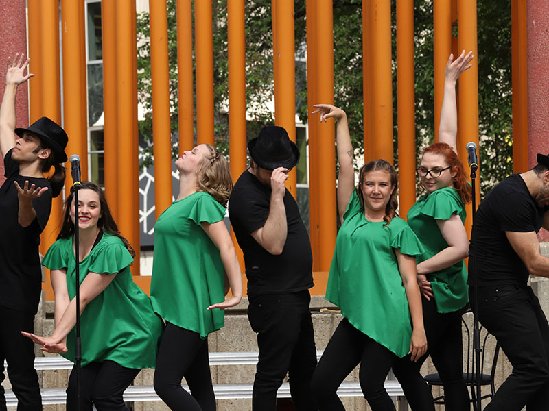 Youth Singers members perform in Olympic Plaza