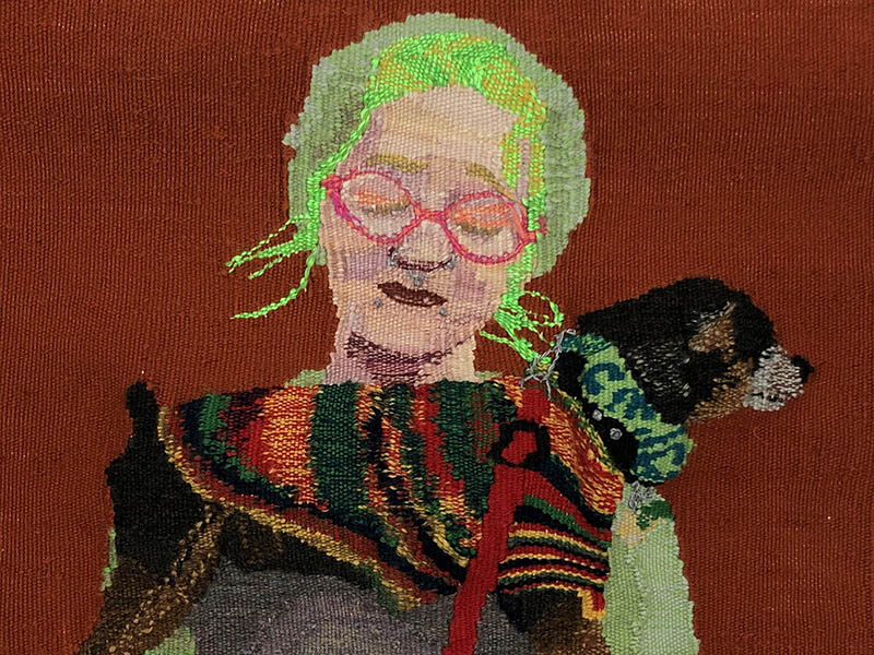 A detail photo of Adele Schatschneider's cross stitch, Our Lady
