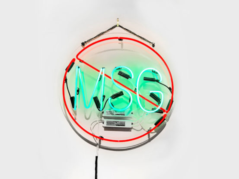 Shellie Zhang's No MSG (In Memory of Lee Garden) is a neon sign with MSG crossed out by a red circle and line