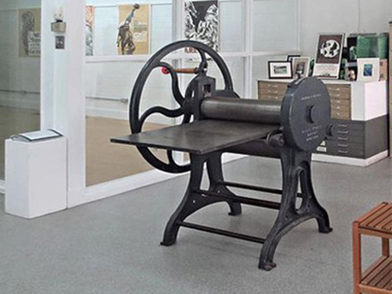 A printing press at the Alberta Printmakers space