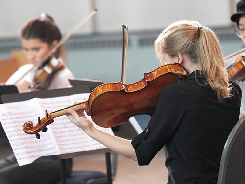 A photo of young people performing in the Amici String Program