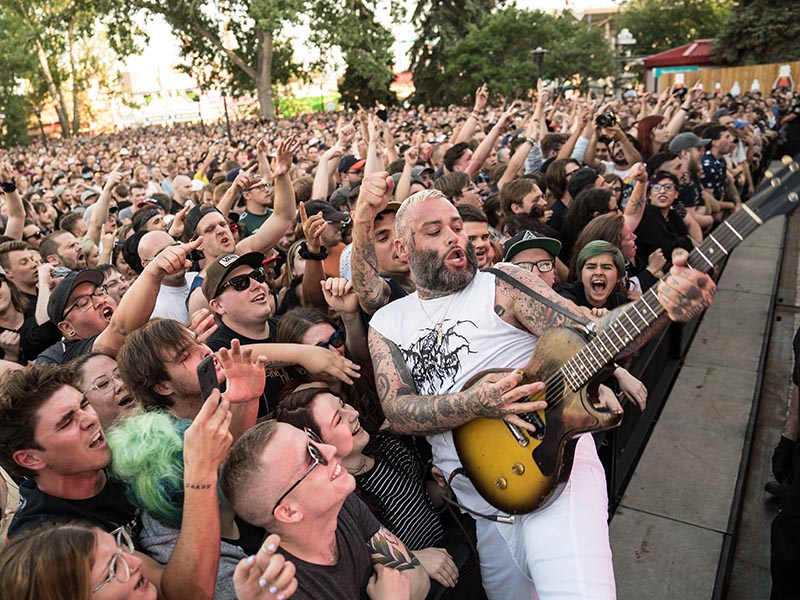 Fans support a guitarist at the Coca-Cola Stage