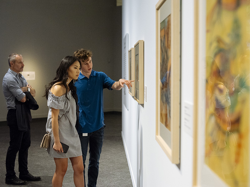 People explore a gallery at Glenbow