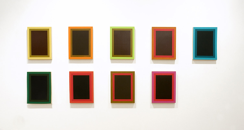 Nelson Henricks' Lacuna features brightly coloured rectangles on a wall