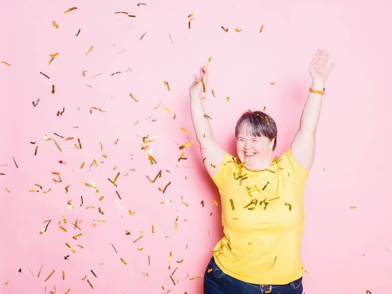 woman celebrates with confetti