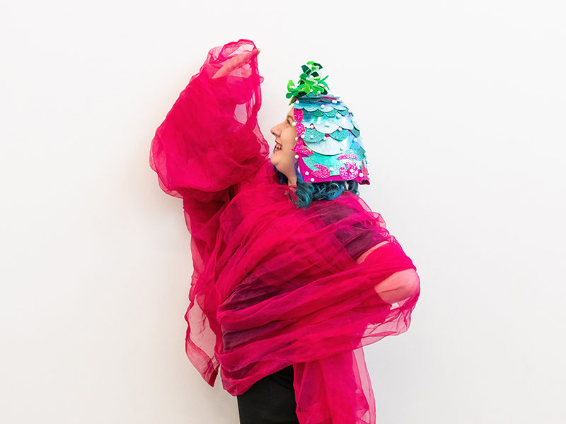 Performer Alicia Morrison draped in a colourful costume