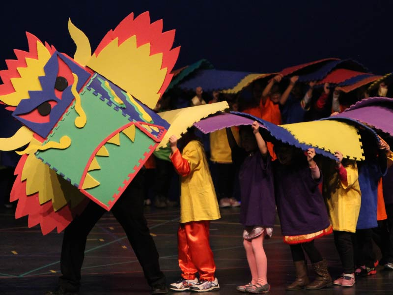 Kids wearing a paper dragon costume