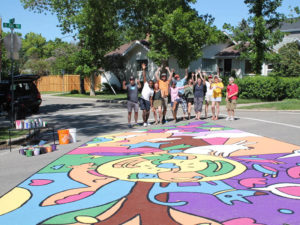 Crescent Heights Community Association shows off a mural on the the corner of 8th Avenue and 1st Street NE