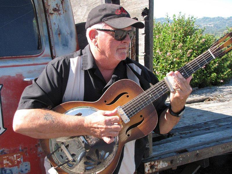 Tim Williams playing guitar