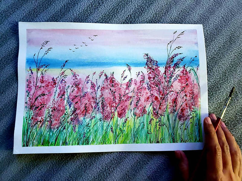 A painting of pink flowers created by Sania Dsilva