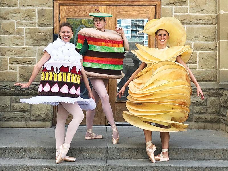 Dancers in food costumes