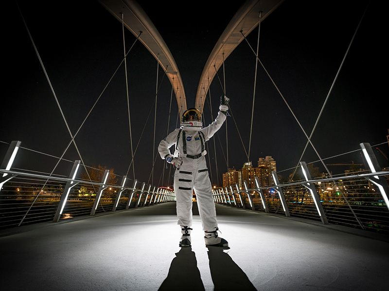A photo of an astronaut on the Skipping Stone Bridge