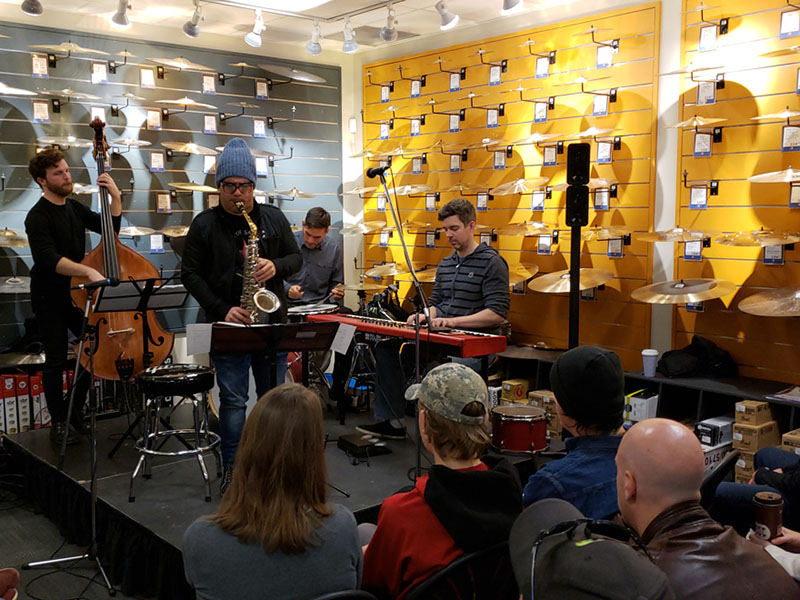 Jazz musicians perform in a music shop