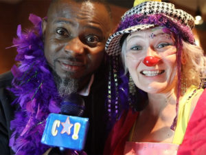 Lanre Ajayi and a clown performer at the Calgary Clown Festival