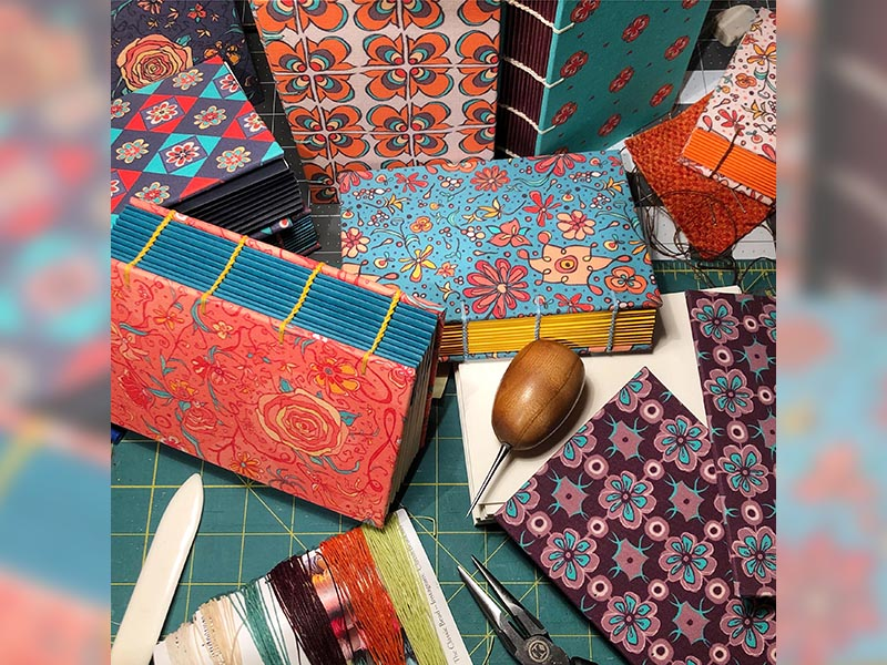 A photo of custom bound books being made