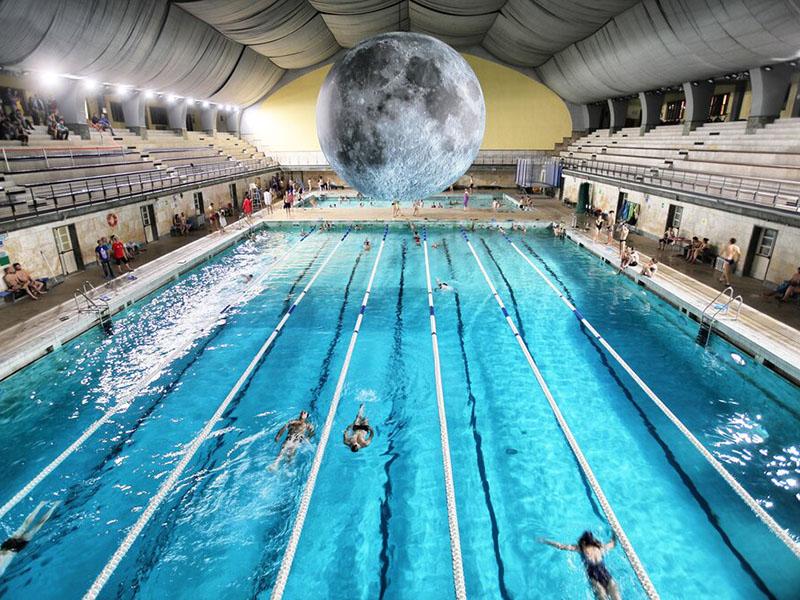 Luke Jerram's Museum of the Moon hangs above Milanosport