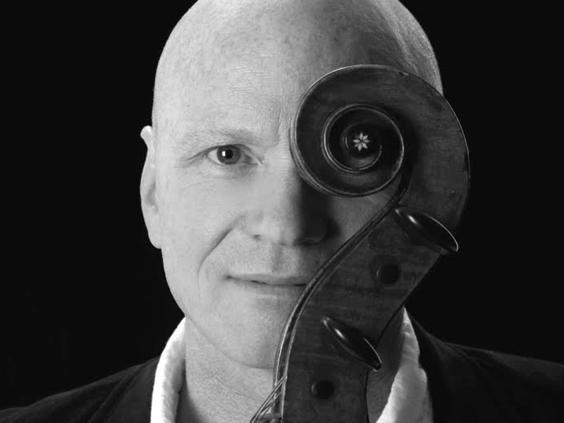 A photo of Phil Hansen and his cello