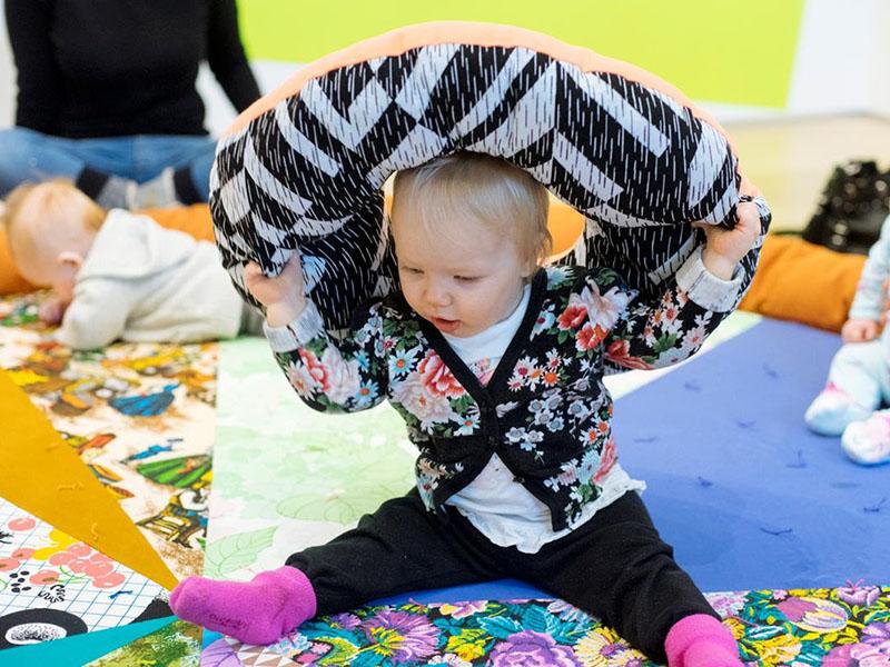A toddler on Yvonne Mullock's Sensory Blanket
