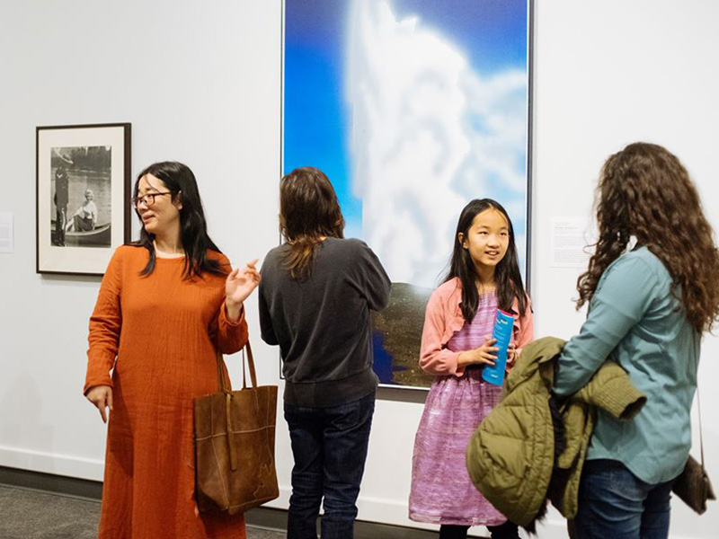 Visitors explore a gallery at Glenbow during Free First Thursday Nights