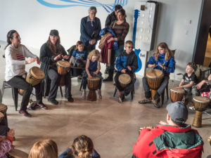 People drumming during Bell Let's Talk Day at Studio Bell