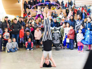 A circus performer at the Central Library