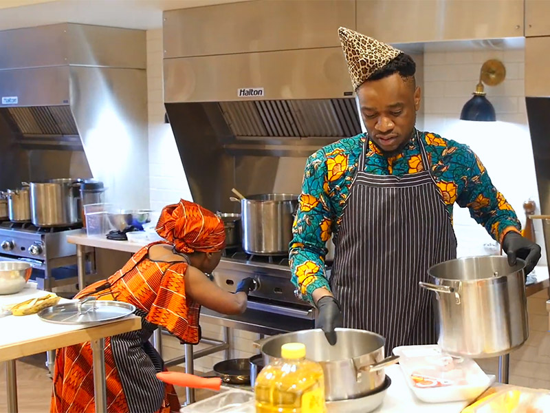 Chefs cooking jollof rice in the ATCO Blue Flame Kitchen