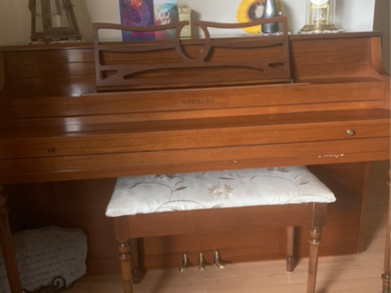 A photo of an upright piano
