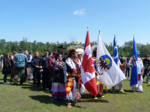 Flags are carried during the National Indigenous Day Celebration