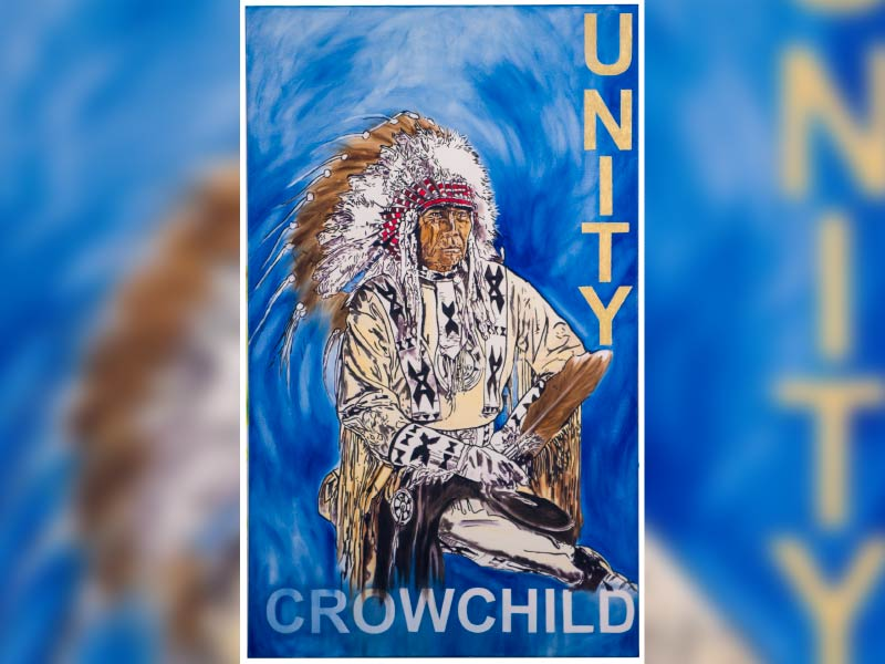 Kim's painting of indigenous man with text that says UNITY and CROWCHILD