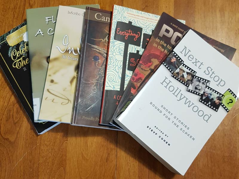 A photo of various books fanned out across table