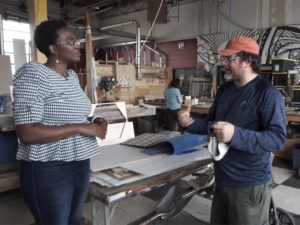 A screen cap from the Living a Creative Life web series of Adora Nwofor and Shannon Hoover at Fuse33 Makerspace