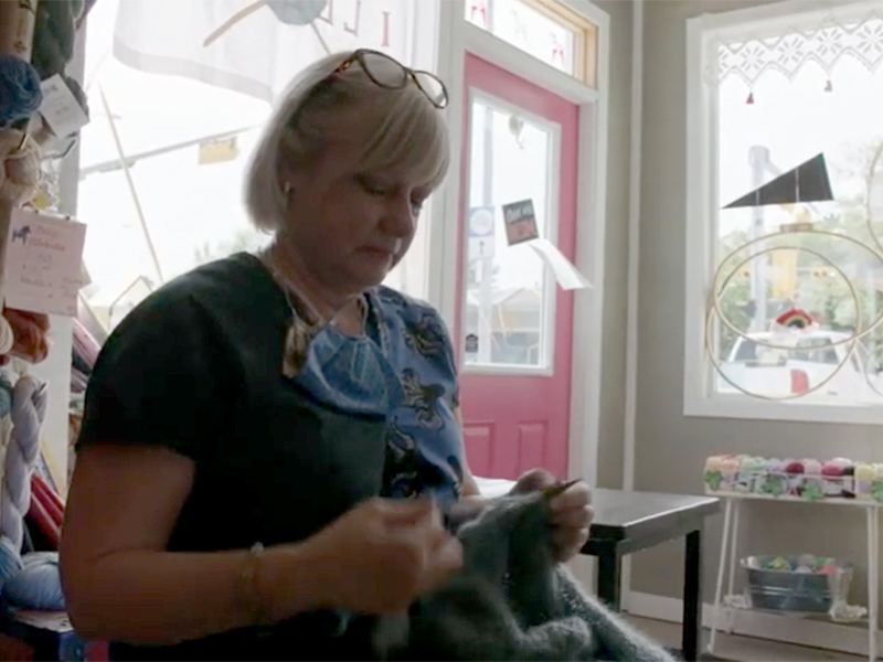 A still of Christine Hamilton knitting at Villekulla