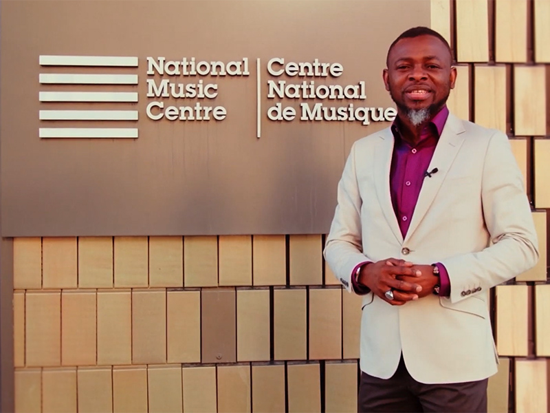 Lanre Ajayi stands outside of Studio Bell, home of the National Music Centre