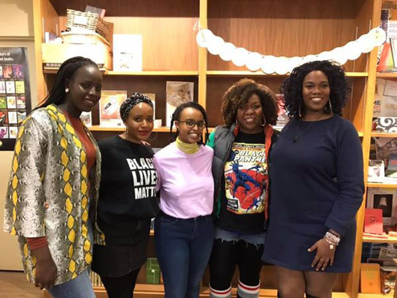 A photo of five Black poets and perfomers at Shelf Life Books