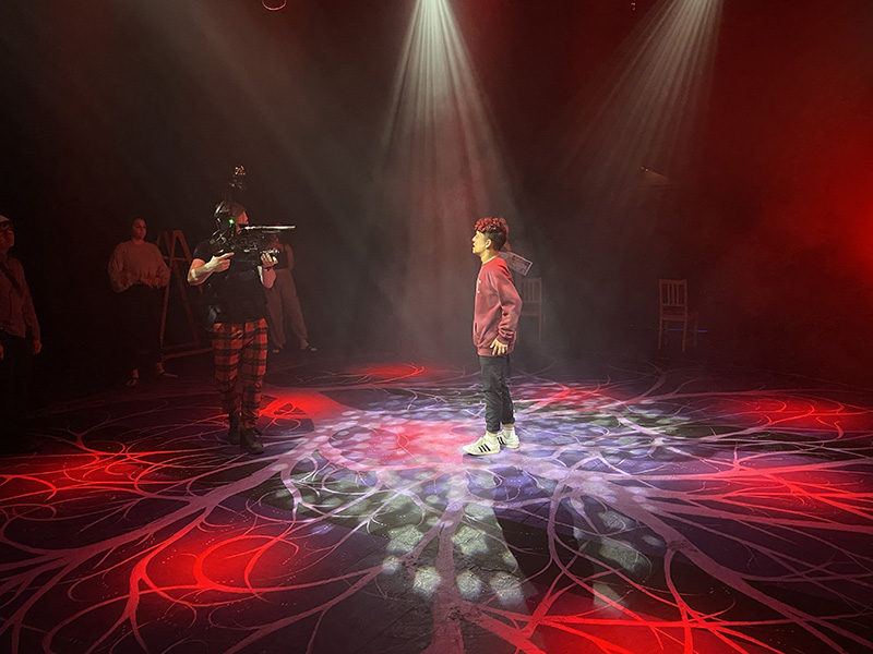 A cast member on stage during the recording of Spring Awakening