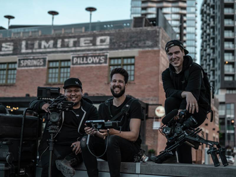 A group of videographers from Vek Labs in front of the Simmons Building in East Village Calgary